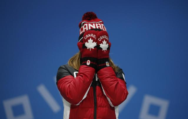 Medals Ceremony - Short Track Speed Skating Events - Pyeongchang 2018 Winter Olympics - Women's 500m - Medals Plaza - Pyeongchang, South Korea - February 14, 2018 - Bronze medallst Kim Boutin of Canada reacts on the podium. REUTERS/Kim Hong-Ji