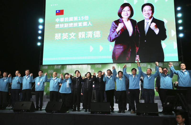 Taiwan's 2020 presidential election candidate, Taiwanese President Tsai Ing-wen, center, celebrate victory with supporters in Taipei, Taiwan, Saturday, Jan. 11, 2020. Taiwan's independence-leaning President Tsai Ing-wen won a second term in a landslide election victory Saturday, signaling strong support for her tough stance against China. (AP Photo/Chiang Ying-ying)