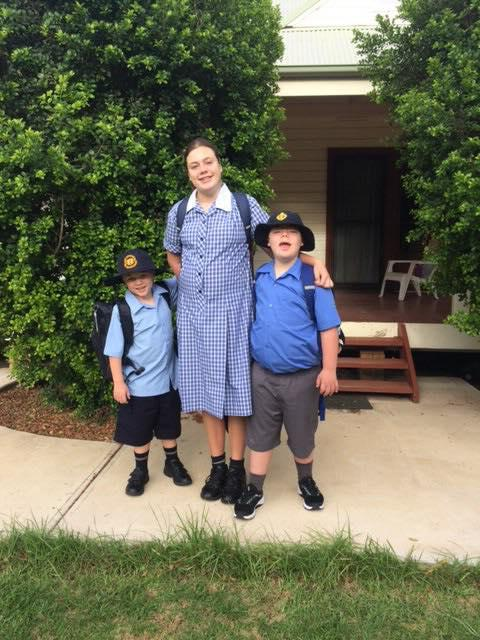 Three siblings with disabilities pictured outside their rural NSW home. They travel 700kms to The Shine Shed in Campbelltown.