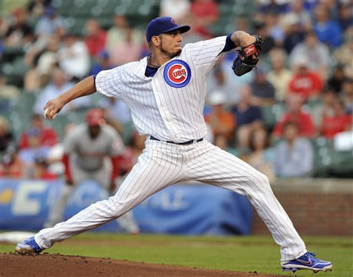 Chicago Cubs' Matt Garza pitches against the Cincinnati Reds during the first inning of a baseball game on Tuesday, June 11, 2013, in Chicago. (AP Photo/Jim Prisching)