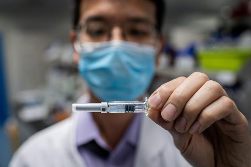 In this picture taken on April 29, 2020, an engineer shows an experimental vaccine for the COVID-19 coronavirus that was tested at the Quality Control Laboratory at the Sinovac Biotech facilities in Beijing. - Sinovac Biotech, which is conducting one of the four clinical trials that have been authorised in China, has claimed great progress in its research and promising results among monkeys. (Photo by NICOLAS ASFOURI / AFP) / TO GO WITH Health-virus-China-vaccine,FOCUS by Patrick Baert (Photo by NICOLAS ASFOURI/AFP via Getty Images)