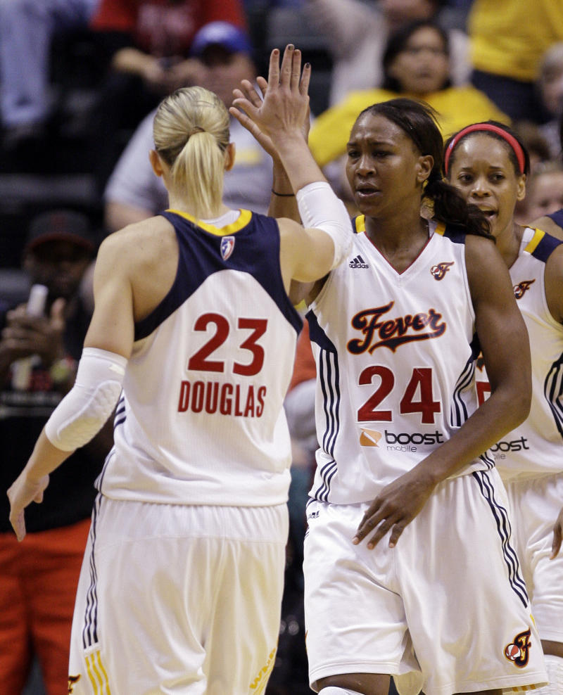 Indiana Fever players Katie Douglas, left, and Tamika Catchings high five after a play late in the second half of a WNBA first round playoff basketball game against the New York Liberty in Indianapolis, Monday, Sept. 19, 2011. The Fever advance to the second round with a 72-62 win over the Liberty.  The face the Atlanta Dream on Thursday. (AP Photo/Michael Conroy)