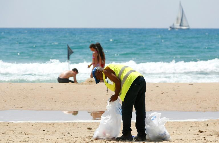 Volunteers join beach cleanups in Israel, whose Tel Aviv coastline was found to be the third most polluted by plastic waste in the Mediterranean in a WWF report in June (AFP Photo/JACK GUEZ)