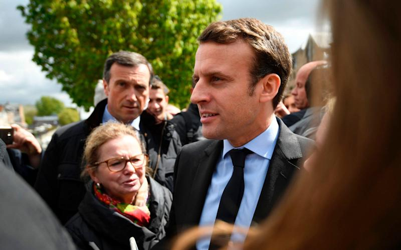 "With less than a fortnight until the final vote, Macron was greeted with chants of ""President Marine"" - Credit: AFP PHOTO / POOL / Eric FEFERBERGERIC FEFERBERG/AFP/Getty Images"