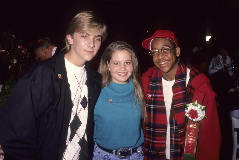 Actors Candace Cameron (center) and Jaleel White (R) are pictured with Jeremy Miller (L) in 1991 (Photo: Ron Galella, Ltd./Ron Galella Collection via Getty Images)