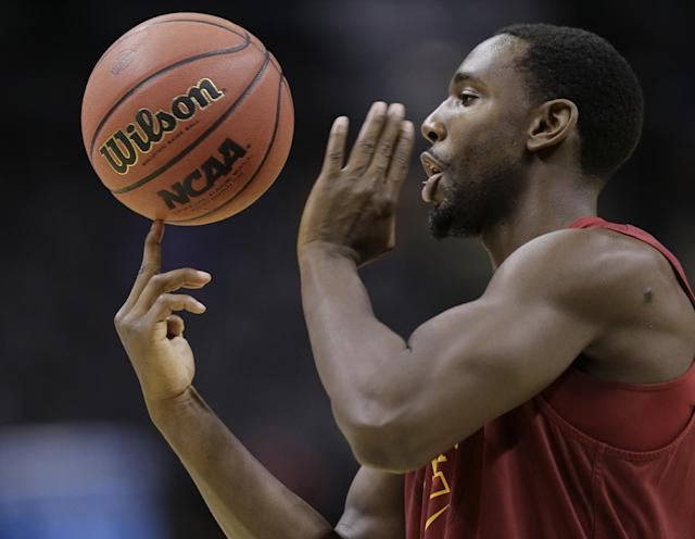 Iowa State's Dustin Hogue plays with a basketball during the team's practice for the NCAA college basketball tournament, Thursday, March 20, 2014, in San Antonio. North Carolina Central will face Iowa State on Friday. (AP Photo/Eric Gay)