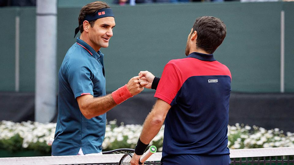 Roger Federer, pictured here congratulating Pablo Andujar after their match at the Geneva Open.