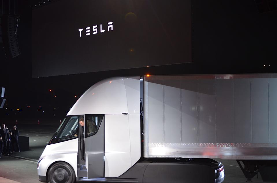 "Tesla Chairman and CEO Elon Musk steps out of the new ""Semi"" electric Truck during the unveiling for buyers and journalists on November 16, 2017 in Hawthorne, California, near Los Angeles.  / AFP PHOTO / Veronique DUPONT        (Photo credit should read VERONIQUE DUPONT/AFP via Getty Images)"