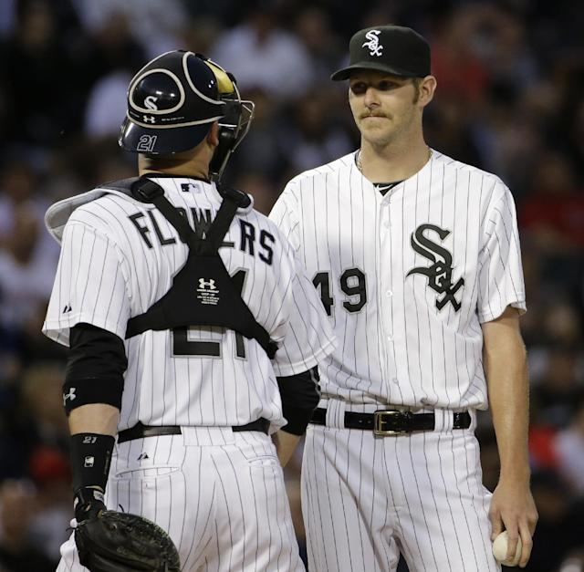 Chicago White Sox starter Chris Sale, right, listens to catcher Tyler Flowers during the fifth inning of a baseball game against the Detroit Tigers in Chicago, Thursday, June 12, 2014. (AP Photo/Nam Y. Huh)