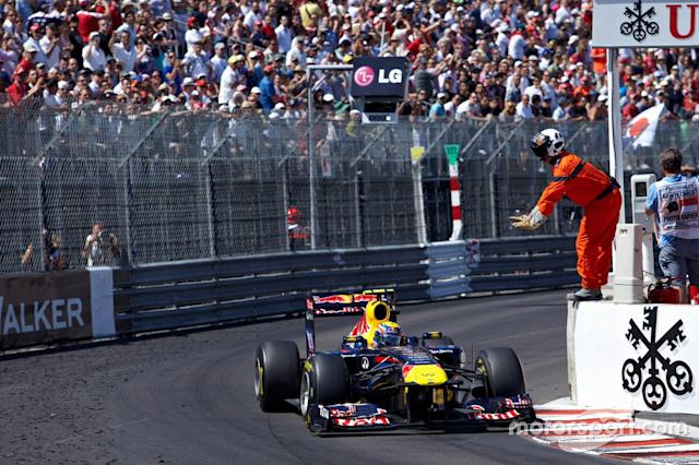 "A marshal signals Mark Webber, Red Bull RB7 Renault, to slow down <span class=""copyright"">Rainer W. Schlegelmilch</span>"