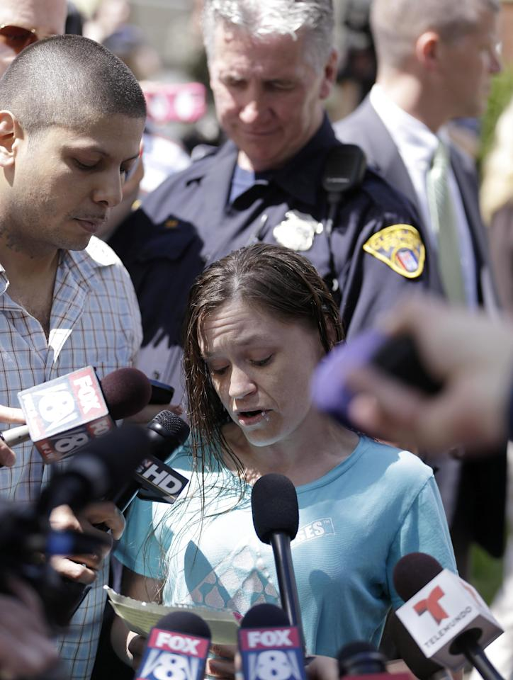 Beth Serrano, sister of Amanda Berry, reads a statement to the media after the arrival of Berry Wednesday, May 8, 2013,at her home in Cleveland. Berry is one of three women missing for about a decade and apparently held captive in the house in Cleveland police said. (AP Photo/Tony Dejak)
