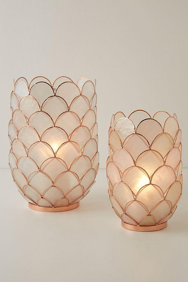 """<h2>Anthropologie Concha Capiz Lantern</h2><br>For your mom, only the most rare tchotchkes are allowed to live on the hallowed grounds of the living room mantle or curio cabinet — and we daresay that these restrained-yet-charming capiz lanterns might make the cut.<br><br><em>Shop gifts at <strong><a href=""""https://www.anthropologie.com/all-gifts"""" rel=""""nofollow noopener"""" target=""""_blank"""" data-ylk=""""slk:Anthropologie"""" class=""""link rapid-noclick-resp"""">Anthropologie</a></strong></em><br><br><strong>Anthropologie</strong> Concha Capiz Lantern, $, available at <a href=""""https://go.skimresources.com/?id=30283X879131&url=https%3A%2F%2Fwww.anthropologie.com%2Fshop%2Fconcha-capiz-lantern%3Fcategory%3Dmothers-day-gifts%26color%3D100%26type%3DSTANDARD%26quantity%3D1%26size%3DL"""" rel=""""nofollow noopener"""" target=""""_blank"""" data-ylk=""""slk:Anthropologie"""" class=""""link rapid-noclick-resp"""">Anthropologie</a>"""