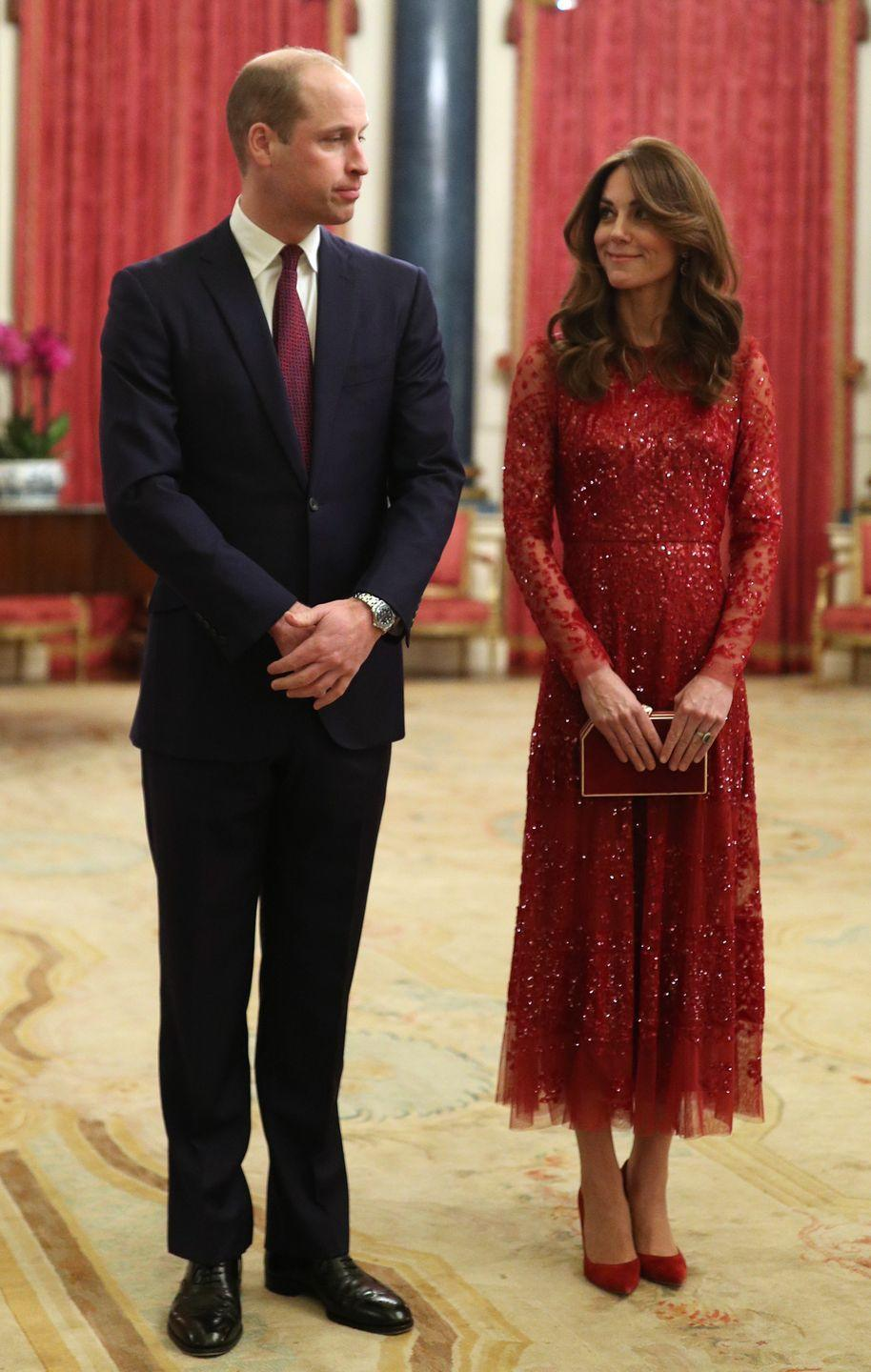 """<p>The Duchess of Cambridge attend a reception to mark the UK-Africa Investment Summit at Buckingham Palace. She wore a dress by <a href=""""https://www.net-a-porter.com/us/en/Shop/Designers/Needle_and_Thread?pn=1&npp=60&image_view=product&dScroll=0"""" rel=""""nofollow noopener"""" target=""""_blank"""" data-ylk=""""slk:Needle & Thread"""" class=""""link rapid-noclick-resp"""">Needle & Thread</a>. </p>"""