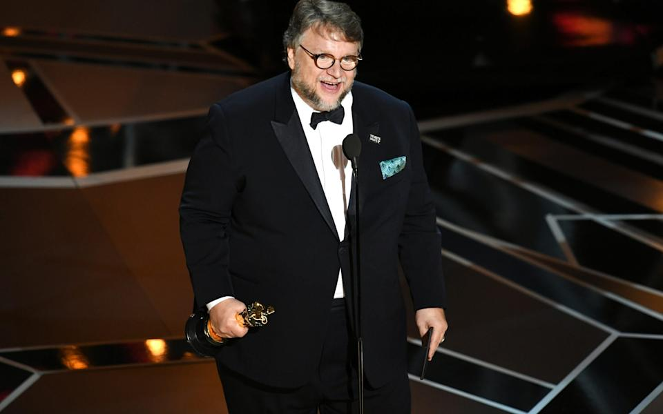 Gullermo del Toro collecting his Oscar for The Shape of Water in 2018 - Getty