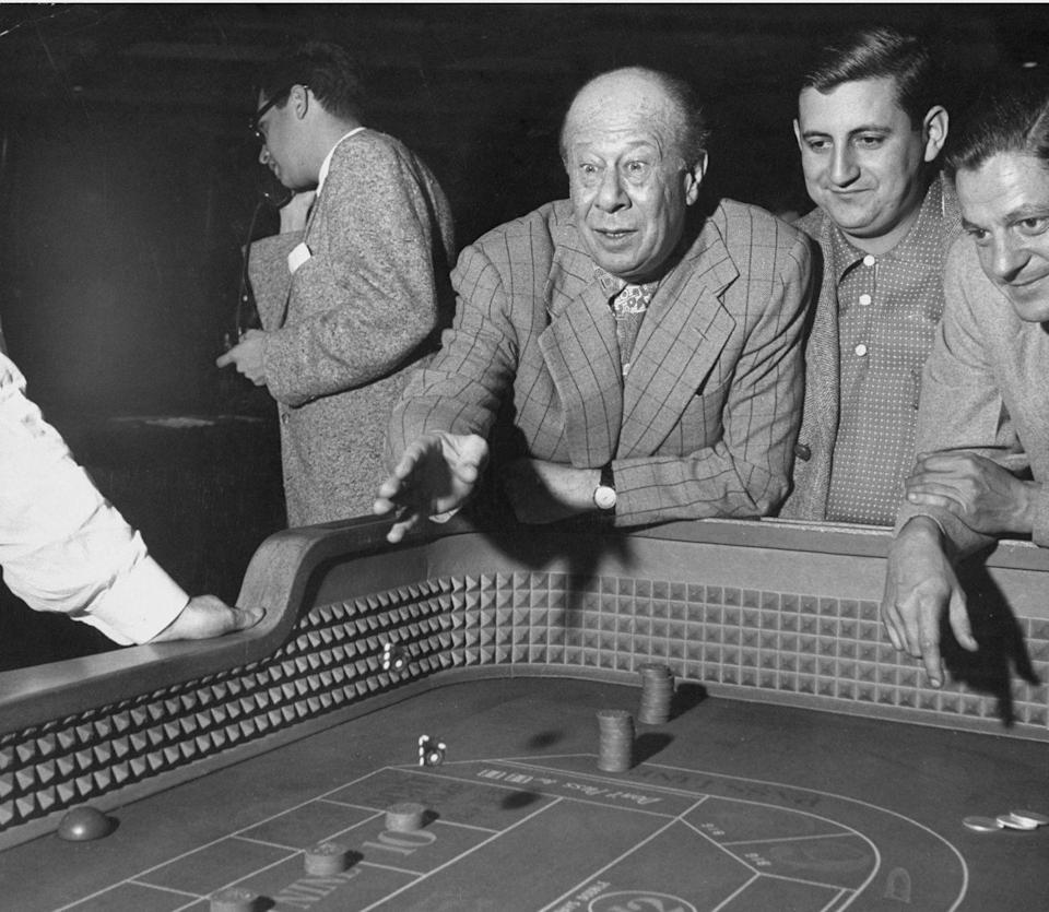 <p>Bert Lahr plays dice in 1952. He is best known for his role as the Cowardly Lion in <em>The Wizard of Oz</em>.</p>
