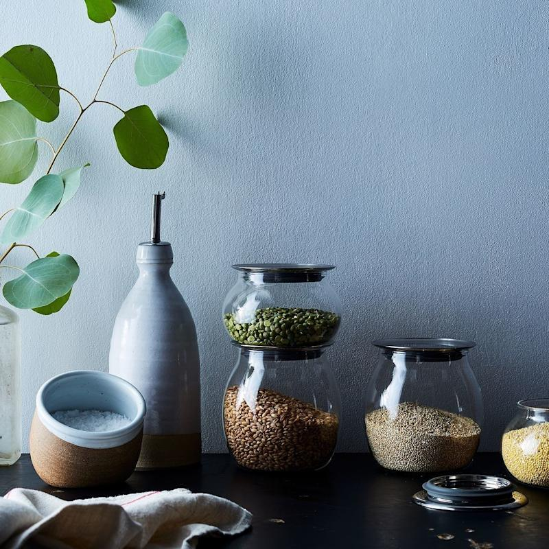 """To store their not-manually-ground coffee grinds. <a href=""""https://food52.com/shop/products/4022-totem-airtight-glass-canisters-set-of-2"""" target=""""_blank"""">Shop them here</a>."""