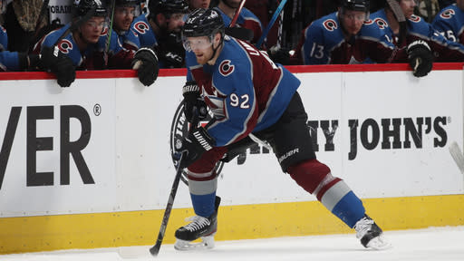 FILE - Colorado Avalanche left wing Gabriel Landeskog moves the puck down the ice in the second period of an NHL hockey game against the Bufalo Sabres in Denver, in this \Wednesday, Feb. 26, 2020, file photo. The Avs are coming off an injury-riddled season in which they advanced to the Western Conference semifinals inside the bubble before being eliminated by Dallas during overtime of Game 7.(AP Photo/David Zalubowski, File)
