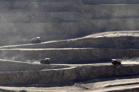 FILE PHOTO: Trucks travel along a road inside Chuquicamata open pit copper mine, which is owned by Chile's state-run copper producer Codelco, near Calama city, April 1, 2011. REUTERS/Ivan Alvarado/File Photo