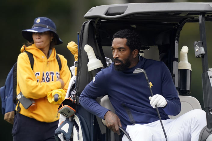 North Carolina A&T's J.R. Smith eyes his next shot on the 17th hole during the first round of the Phoenix Invitational golf tournament in Burlington, N.C., Monday, Oct. 11, 2021. Smith, who spent 16 years in the NBA, made his college golfing debut in the tournament hosted by Elon. (AP Photo/Gerry Broome)