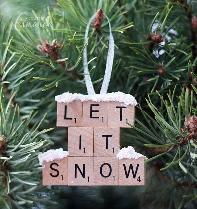 """<p>Add the title of your favorite Christmas tune to your tree by using Scrabble tiles.</p><p><strong>Get the tutorial at <a href=""""http://craftsbyamanda.com/let-snow-scrabble-tile-ornament/"""" rel=""""nofollow noopener"""" target=""""_blank"""" data-ylk=""""slk:Crafts by Amanda"""" class=""""link rapid-noclick-resp"""">Crafts by Amanda</a>. </strong><br></p>"""