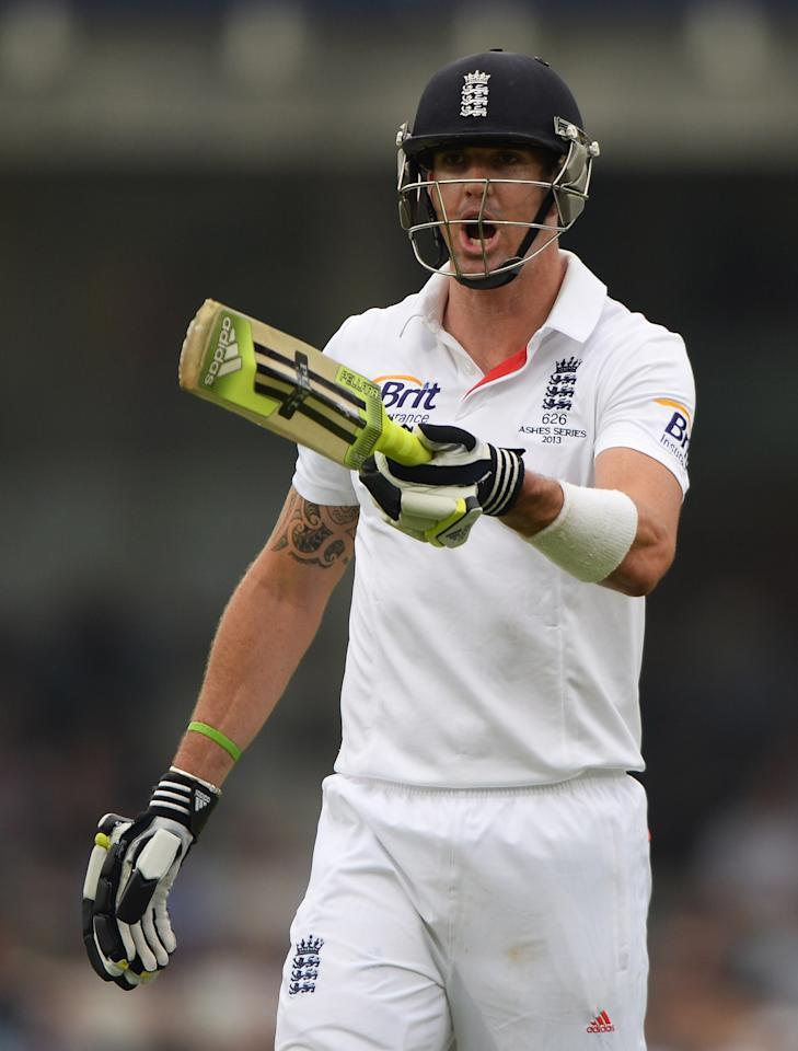 LONDON, ENGLAND - AUGUST 23:  Kevin Pietersen of England moves spectators behind the bowlers arm during day three of the 5th Investec Ashes Test match between England and Australia at the Kia Oval on August 23, 2013 in London, England.  (Photo by Gareth Copley/Getty Images)