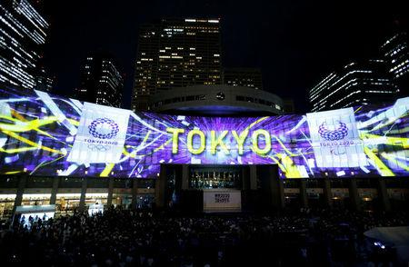 Images, using projection-mapping technology, are beamed on a building of Tokyo Metropolitan Government Office during a countdown event to mark three years until the Tokyo 2020 Summer Olympics in Tokyo, Japan July 24, 2017.  REUTERS/Toru Hanai