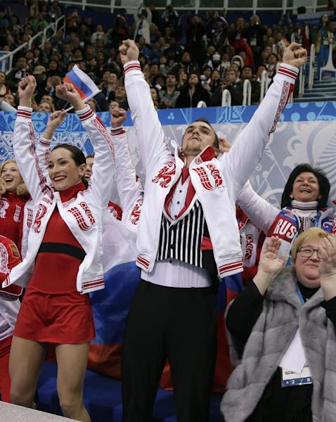 Ksenia Stolbova and Fedor Klimov of Russia react after competing in the team pairs free skate figure skating competition at the Iceberg Skating Palace during the 2014 Winter Olympics, Saturday, Feb. 8, 2014, in Sochi, Russia. (AP Photo/Darron Cummings, Pool)