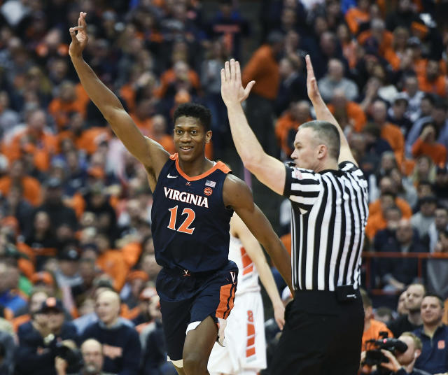 Virginia guard De'Andre Hunter celebrates a three-point basket during the second half of an NCAA college basketball game against Syracuse in Syracuse, N.Y., Monday, March 4, 2019. (AP Photo/Adrian Kraus)