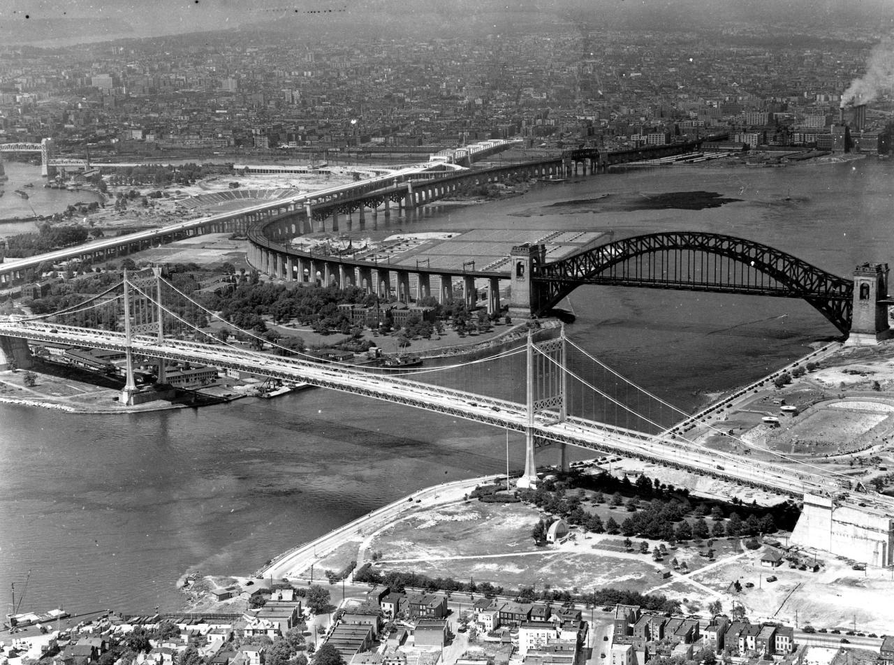 This is a photo of the soon to be complete Triborough Bridge taken from the Queens side of New York City on July 7, 1936.  The bridge links Bronx, Manhattan and Queens. Hells Gate Railroad Bridge is in background.  (AP Photo/Rudy Arnold)