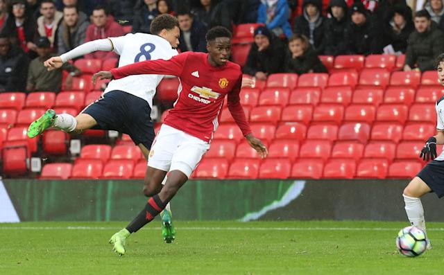 Matthew Olosunde in action for Manchester United's under-23s. He has received his first U.S. call-up. (Getty)