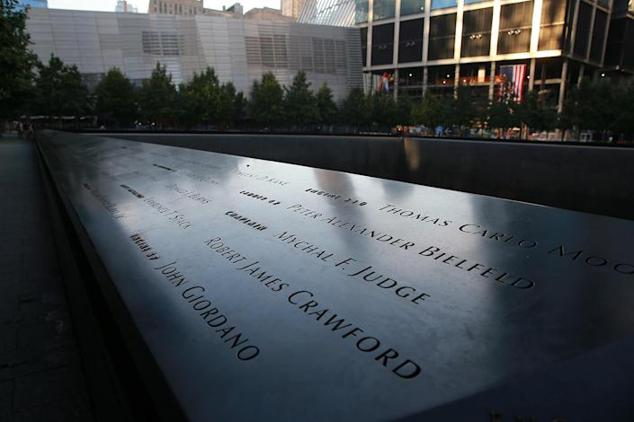 <p>The panels with the names of victims from the Sept. 11, 2001, attacks are reflected by the morning light on Sept. 8, 2016.(Gordon Donovan/Yahoo News) </p>