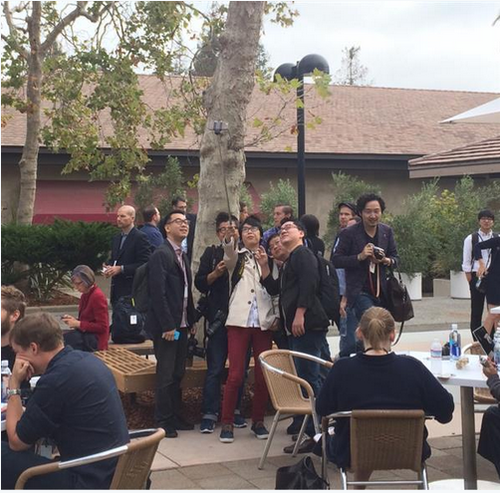 Journalists taking a selfie with a selfie stick