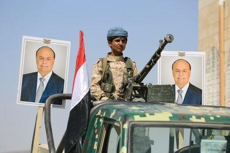 Police trooper mans a machine gun mounted on a patrol truck securing a street where people loyal to Yemen's President Abd-Rabbu Mansour Hadi demonstrated to show support to Hadi in the country's northern city of Marib