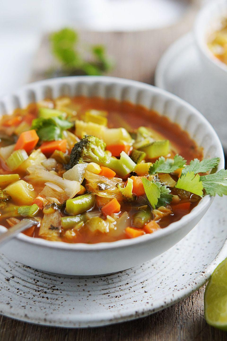 """<p>Show your whole body some love with this nutrient-dense soup containing broccoli, zucchini, carrots, celery, corn, cabbage, chayote (a gourd common in Latin cuisine), and potatoes. You can make this year round: Feel free to swap any of the veggies for those that are in season. </p><p><a class=""""link rapid-noclick-resp"""" href=""""https://www.muydelish.com/sopa-de-verduras/"""" rel=""""nofollow noopener"""" target=""""_blank"""" data-ylk=""""slk:GET THE RECIPE"""">GET THE RECIPE</a></p><p><em>Per serving: 110 calories, 1 g fat (0 g saturated), 630 mg sodium, 23 g carbs, 6 g sugar, 5 g fiber, 6 g protein</em></p>"""