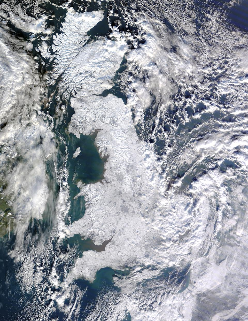Snow blanketed Great Britain on January 7, 2010 captured by NASA's Moderate Resolution Imaging Spectroradiometer. (PA)