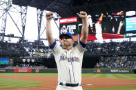 Seattle Mariners third baseman Kyle Seager motions to fans after a baseball game against the Los Angeles Angels, Sunday, Oct. 3, 2021, in Seattle. (AP Photo/Elaine Thompson)