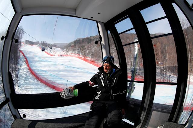 """Heinz Haemmerle, or """"Magic Heinzi"""" as US skier Lindsey Vonn calls her Austrian-born ski technician, sits in a gondola on his way to the women's second Olympic Downhill training at the Winter Olympics 2018 in Pyeongchang, South Korea February 19, 2018. Picture taken February 19, 2018. REUTERS/Leonhard Foeger"""