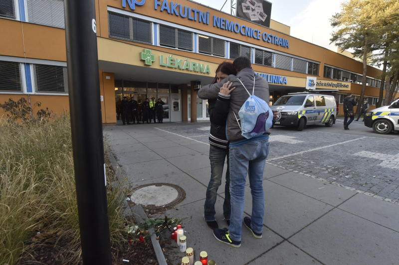 People embrace outside the Ostrava Teaching Hospital after a shooting incident in Ostrava, Czech Republic, Tuesday, Dec. 10, 2019. Police and officials say six people have been killed in a shooting in a hospital in the eastern Czech Republic. Two others are seriously injured. (Jaroslav Ozana/CTK via AP)