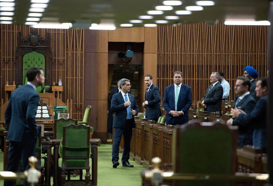 Conservative MPs, including leader Andrew Scheer, wait for the speaker's parade to arrive, as a limited number of MPs return to the house to discuss measures to respond to the COVID-19 outbreak, in Ottawa, on March 24, 2020.  (Photo: Justin Tang/CP)