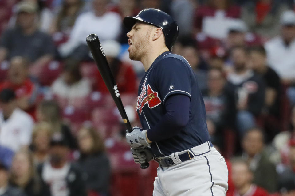 Atlanta Braves' Freddie Freeman reacts after being hit by a pitch from Cincinnati Reds starting pitcher Tanner Roark in the fifth inning of a baseball game, Wednesday, April 24, 2019, in Cincinnati. (AP Photo/John Minchillo)