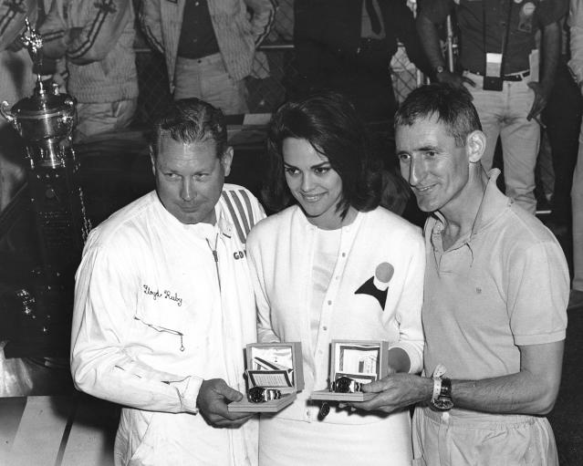 Ken Miles (right) and Lloyd Ruby were presented with Rolex watches in victory lane at Daytona International Speedway for winning a sports car race Feb. 28, 1965. A year later, they would win the first 24-hour race at the track (Photo by ISC Images & Archives via Getty Images)