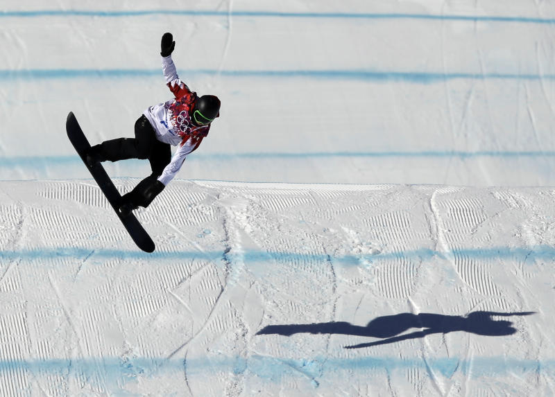 Canada's Mark McMorris lands from a jump during the men's snowboard slopestyle qualifying at the Rosa Khutor Extreme Park ahead of the 2014 Winter Olympics, Thursday, Feb. 6, 2014, in Krasnaya Polyana, Russia. (AP Photo/Andy Wong)