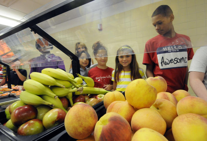 Students select food items from the lunch line of the cafeteria at Draper Middle School in Rotterdam, N.Y., Tuesday, Sept. 11, 2012. The leaner, greener school lunches served under new federal standards are getting mixed grades from students. (AP Photo/Hans Pennink)