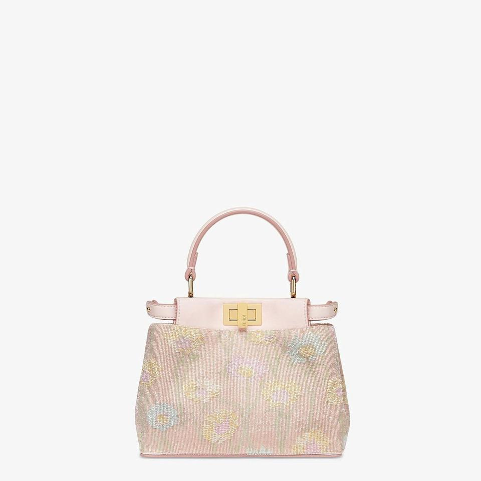 "<p>Bag, £5,000, Fendi</p><p><a class=""link rapid-noclick-resp"" href=""https://go.redirectingat.com?id=127X1599956&url=https%3A%2F%2Fwww.fendi.com%2Fgb%2Fbags-woman%2Fpeekaboo-iconic-xs-8bn309acymf19e9%3Ffrom%3Dsearch&sref=https%3A%2F%2Fwww.townandcountrymag.com%2Fuk%2Fstyle%2Ffashion%2Fg32741166%2Fstyle-icon-lupita-nyongo%2F"" rel=""nofollow noopener"" target=""_blank"" data-ylk=""slk:SHOP NOW"">SHOP NOW</a></p>"