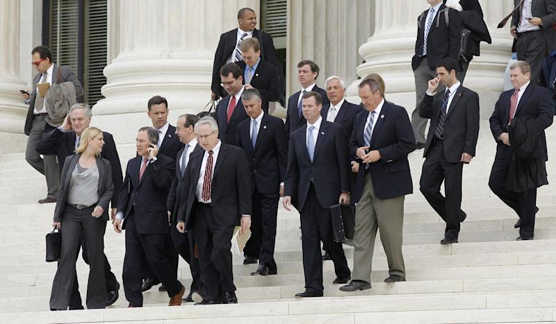 FILE - In this March 28, 2012, file photo states' attorney generals, including Florida's Pam Bondi, left, walk down the steps of the U.S. Supreme Court in Washington at the end of arguments on the constitutionality of the health care law signed by President Barack Obama. Chances are slim that Congress would act to restore any parts of the law that the court might strike down, even noncontroversial provisions. (AP Photo/Charles Dharapak, File)