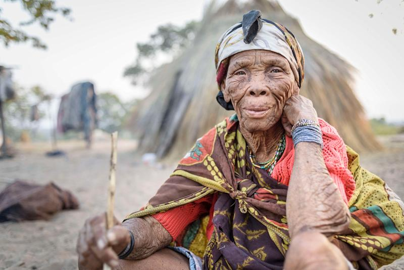 NAMIBIA - 2015/07/14: Portrait of an old woman from the bushmen tribe in front of her hut made out of grass. (Photo by Jorge Fernández/LightRocket via Getty Images) (Photo: Jorge Fernández via Getty Images)