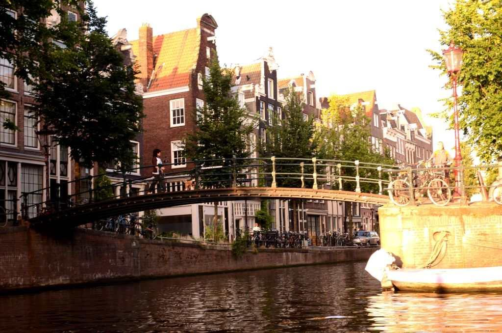 "The canals take you into a different part of Amsterdam. The painter Rembrandt's house is located on the banks of the Zwanenburgwal, a canal that was once the hub of the textile industry called ""dyer's canal"". The red-light area of Amsterdam, with its coffee-houses and legalised prostitution, has a beautiful canal flowing down its streets."