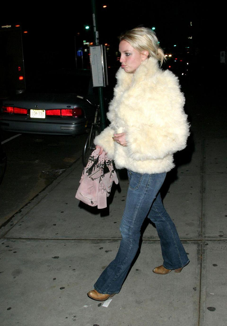 <p>Now that it's winter, this huge fuzzy coat looks so warm. The flared jeans and ankle boots totally complete this cold-weather ensemble.</p>