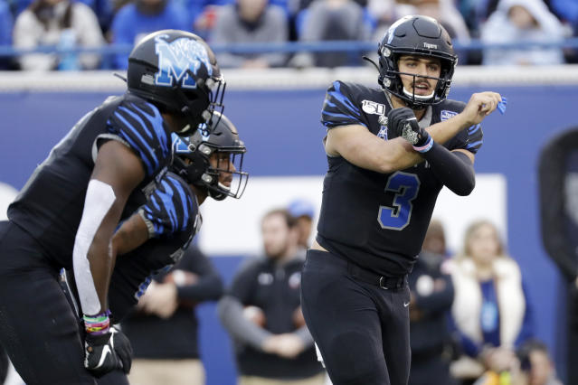 Memphis quarterback Brady White (3) calls a play against Cincinnati in the first half of an NCAA college football game Friday, Nov. 29, 2019, in Memphis, Tenn. (AP Photo/Mark Humphrey)
