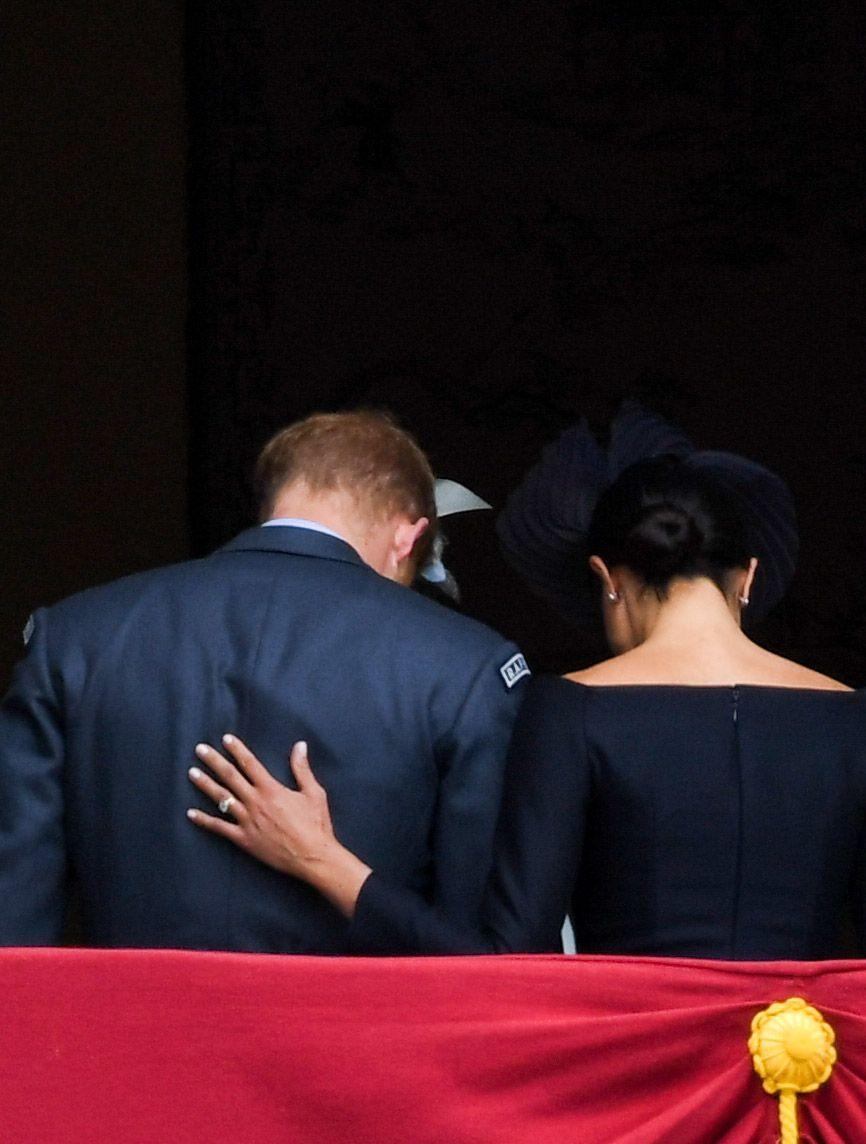 <p>Following their appearance on Buckingham Palace's balcony in July 2018, Dior-dressed Meghan caressed her husband's back and we wanted to cry with happiness. </p>